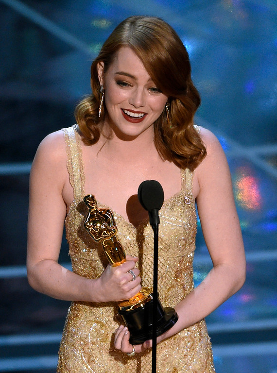 ". Emma Stone accepts the award for best actress in a leading role for ""La La Land\"" at the Oscars on Sunday, Feb. 26, 2017, at the Dolby Theatre in Los Angeles. (Photo by Chris Pizzello/Invision/AP)"