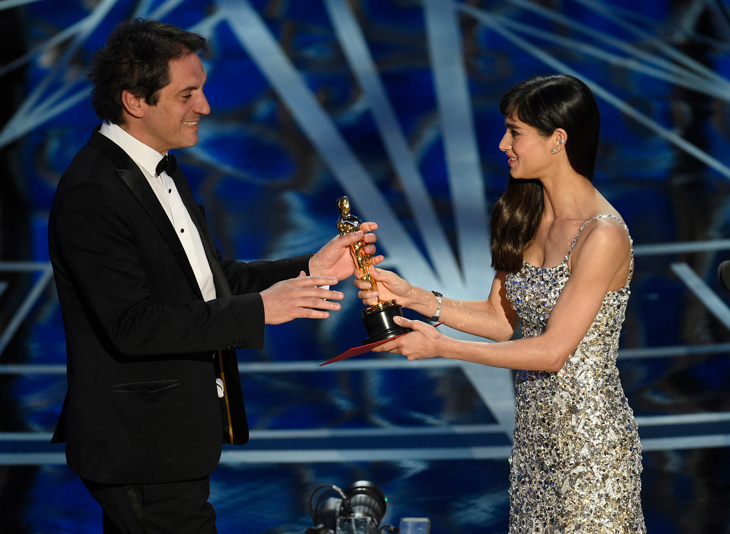 """. Sofia Boutella, right, presents Sylvain Bellemare with the award for best sound editing for \""""Arrival\"""" at the Oscars on Sunday, Feb. 26, 2017, at the Dolby Theatre in Los Angeles. (Photo by Chris Pizzello/Invision/AP)"""