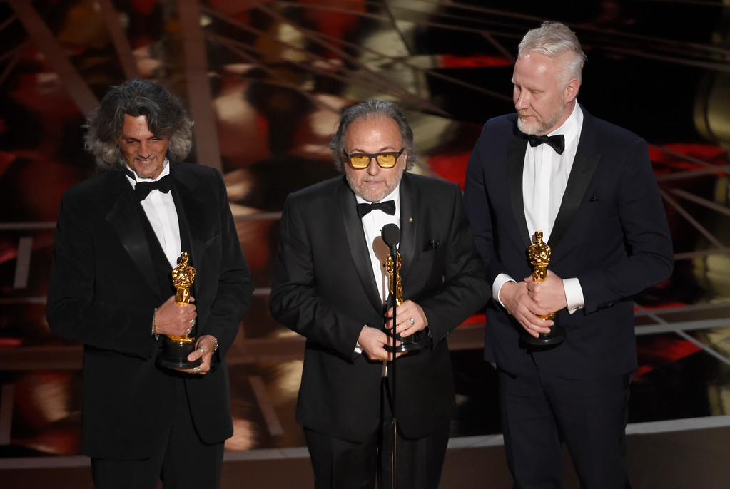 """. Giorgio Gregorini, from left, Alessandro Bertolazzi, and Christopher Allen Nelson accept the award for best makeup and hairstyling for \""""Suicide Squad\"""" at the Oscars on Sunday, Feb. 26, 2017, at the Dolby Theatre in Los Angeles. (Photo by Chris Pizzello/Invision/AP)"""