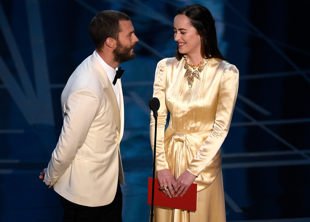 . Jamie Dornan, left, and Dakota Johnson present the award for best production design at the Oscars on Sunday, Feb. 26, 2017, at the Dolby Theatre in Los Angeles. (Photo by Chris Pizzello/Invision/AP)