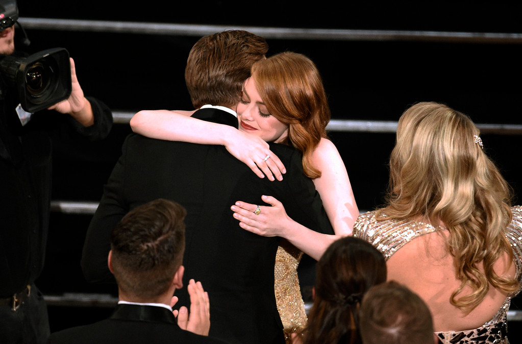 """. Ryan Gosling, right, congratulates Emma Stone as she accepts the award for best actress in a leading role for \""""La La Land\"""" at the Oscars on Sunday, Feb. 26, 2017, at the Dolby Theatre in Los Angeles. (Photo by Chris Pizzello/Invision/AP)"""