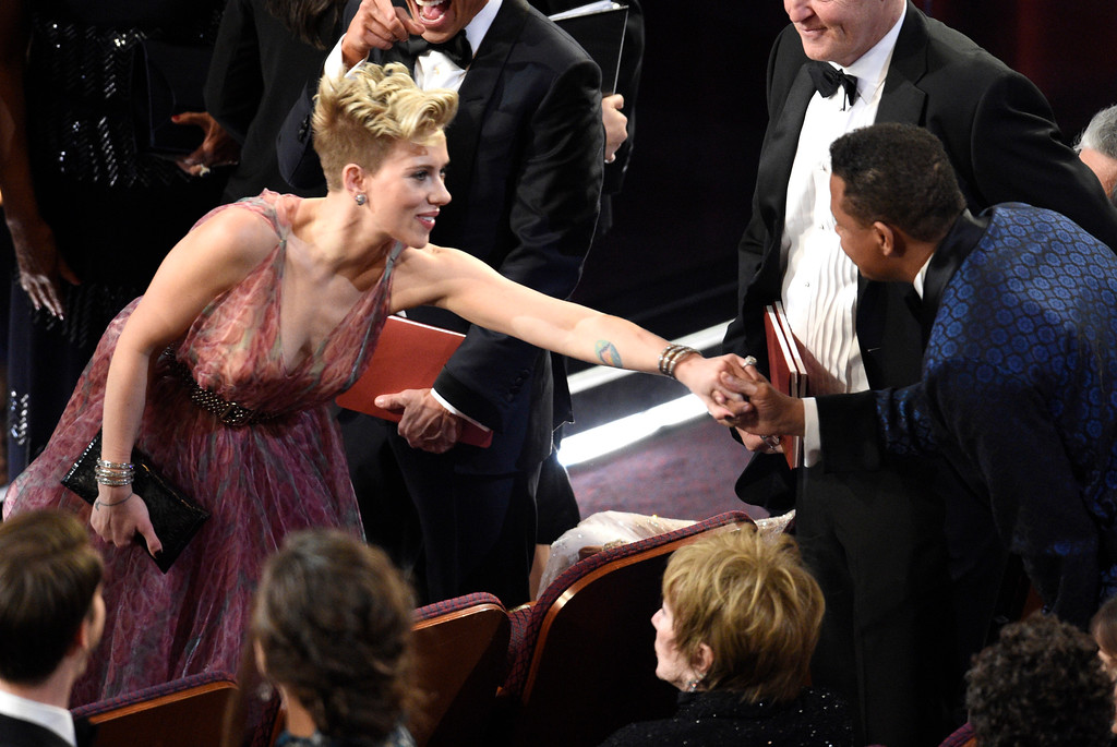 . Scarlett Johansson, left, and Terrence Howard greet each other in the audience at the Oscars on Sunday, Feb. 26, 2017, at the Dolby Theatre in Los Angeles. (Photo by Chris Pizzello/Invision/AP)