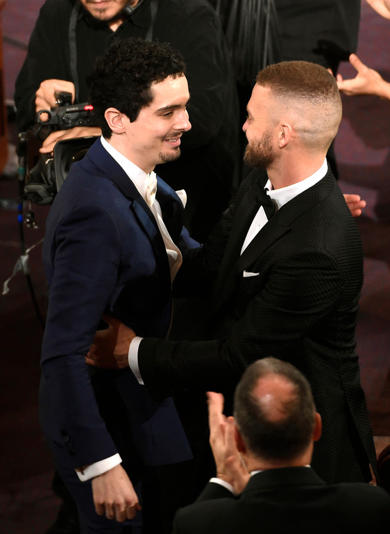 ". Justin Timberlake, right, congratulates Damien Chazelle as he accepts the award for best director for ""La La Land\"" at the Oscars on Sunday, Feb. 26, 2017, at the Dolby Theatre in Los Angeles. (Photo by Chris Pizzello/Invision/AP)"
