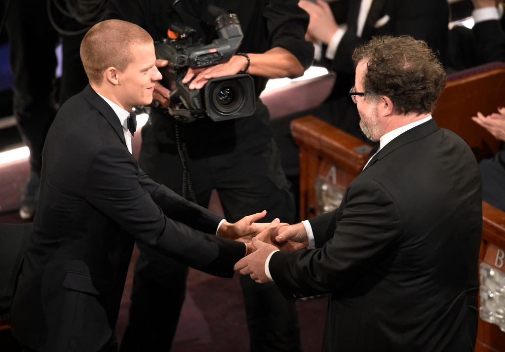 """. Lucas Hedges, left, congratulates Kenneth Lonergan for the award for best original screenplay for \""""Manchester by the Sea\"""" at the Oscars on Sunday, Feb. 26, 2017, at the Dolby Theatre in Los Angeles. (Photo by Chris Pizzello/Invision/AP)"""
