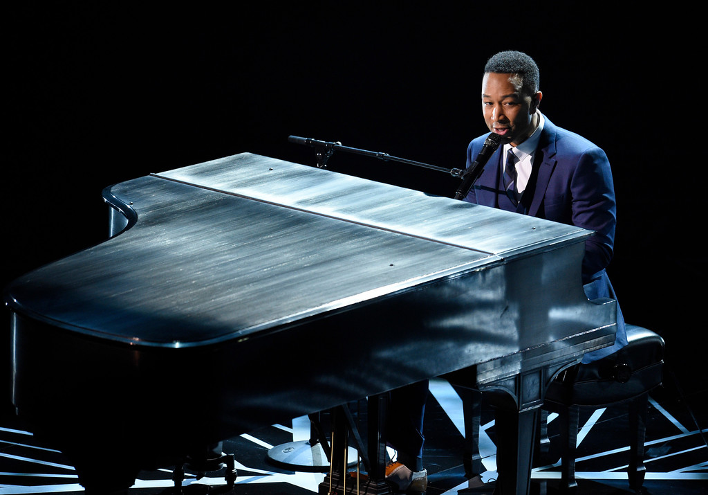 ". John Legend performs songs from best original song nominees ""City of Stars\"" and \""Audition\"" from \""La La Land\"" at the Oscars on Sunday, Feb. 26, 2017, at the Dolby Theatre in Los Angeles. (Photo by Chris Pizzello/Invision/AP)"
