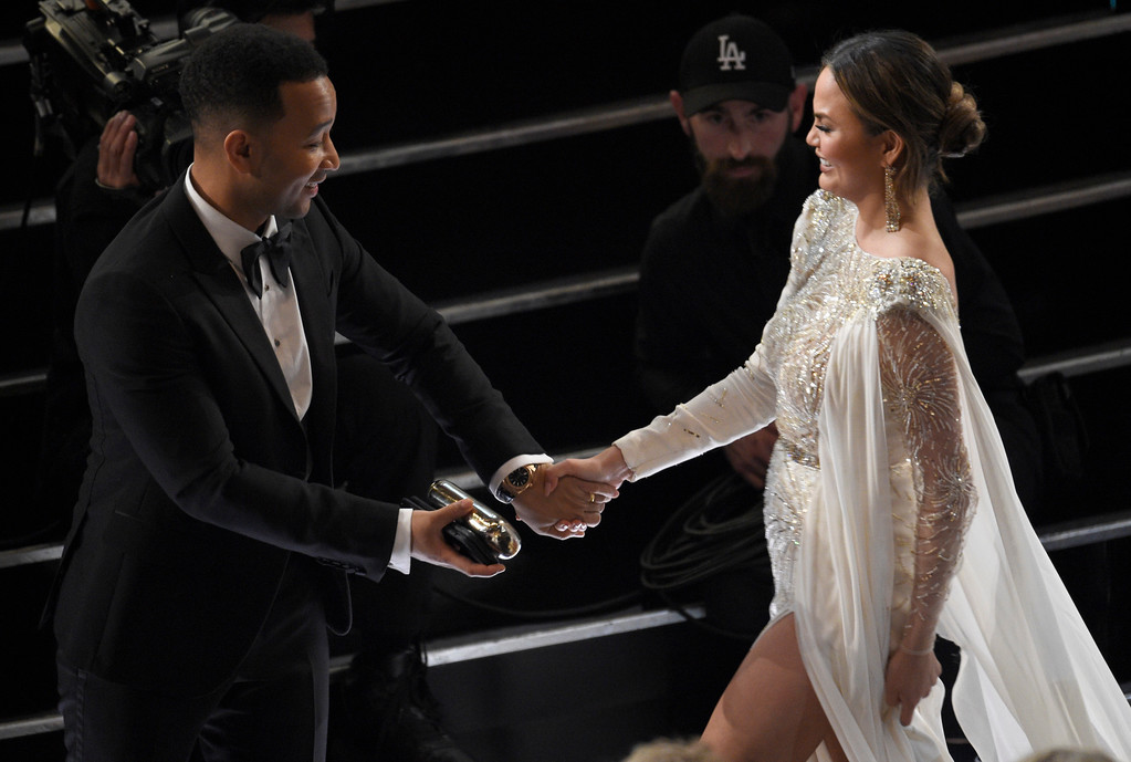 . John Legend, left, and Chrissy Teigen appear in the audience at the Oscars on Sunday, Feb. 26, 2017, at the Dolby Theatre in Los Angeles. (Photo by Chris Pizzello/Invision/AP)