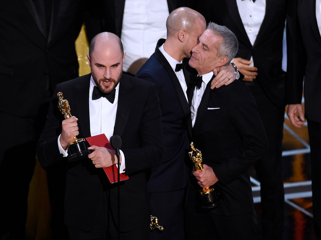 ". Jordan Horowitz, left, of ""La La Land,\"" mistakenly accepts the award for best picture at the Oscars on Sunday, Feb. 26, 2017, at the Dolby Theatre in Los Angeles. It was later determined that \""Moonlight,\"" won best picture. (Photo by Chris Pizzello/Invision/AP)"