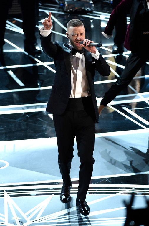 """. Justin Timberlake performs songs from best original song nominee \""""Can\'t Stop the Feeling,\"""" from \""""Trolls\"""" at the Oscars on Sunday, Feb. 26, 2017, at the Dolby Theatre in Los Angeles. (Photo by Chris Pizzello/Invision/AP)"""