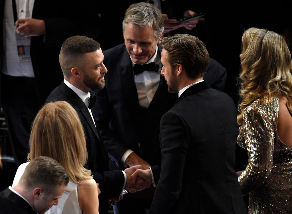 . Justin Timberlake, from left, Viggo Mortensen, and Ryan Gosling speak in the audience at the Oscars on Sunday, Feb. 26, 2017, at the Dolby Theatre in Los Angeles. (Photo by Chris Pizzello/Invision/AP)