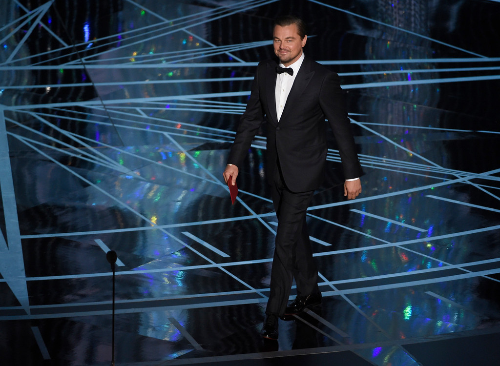 . Leonardo DiCaprio walks on stage to present the award for best actress in a leading role at the Oscars on Sunday, Feb. 26, 2017, at the Dolby Theatre in Los Angeles. (Photo by Chris Pizzello/Invision/AP)