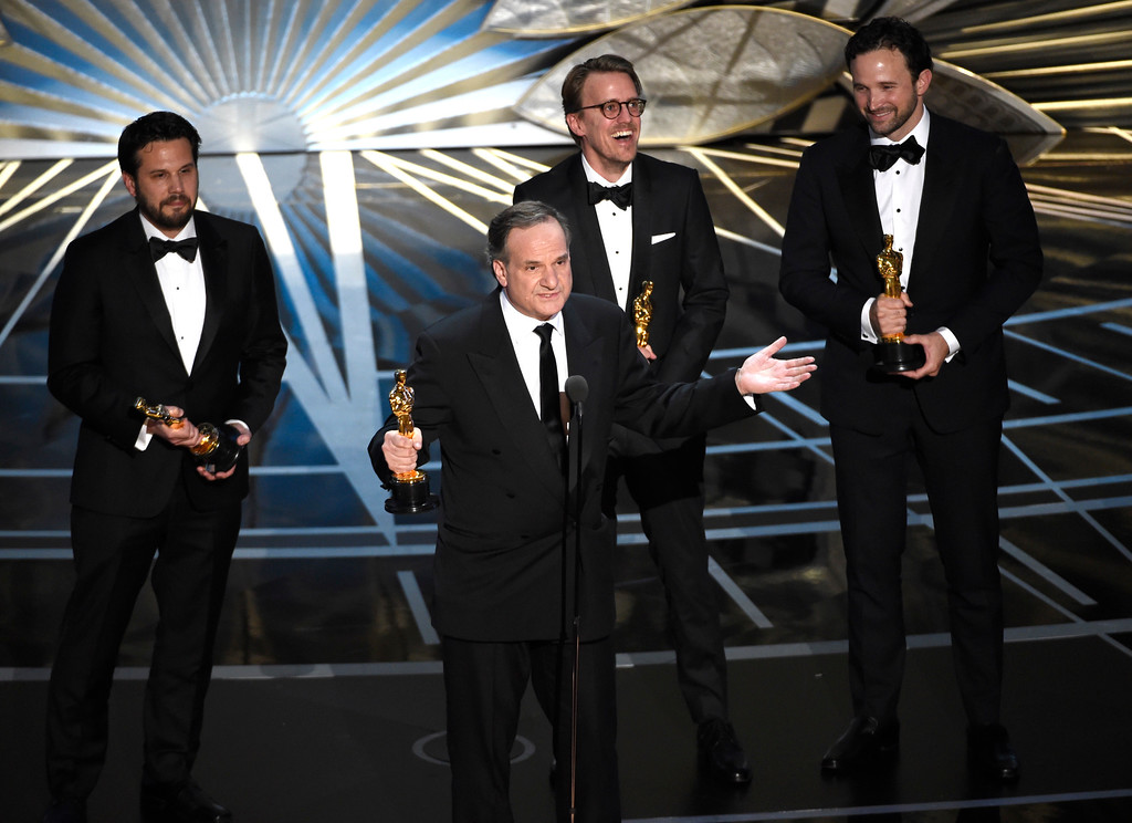 ". Adam Valdez, from left, Robert Legato, Andrew R. Jones, and Dan Lemmon accept the award for best visual effects for ""The Jungle Book\"" at the Oscars on Sunday, Feb. 26, 2017, at the Dolby Theatre in Los Angeles. (Photo by Chris Pizzello/Invision/AP)"