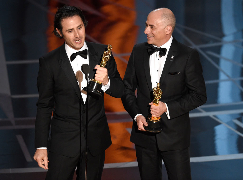 """. Alan Barillaro, left, and Marc Sondheimer accept the award for best animated short film for \""""Piper\"""" at the Oscars on Sunday, Feb. 26, 2017, at the Dolby Theatre in Los Angeles. (Photo by Chris Pizzello/Invision/AP)"""