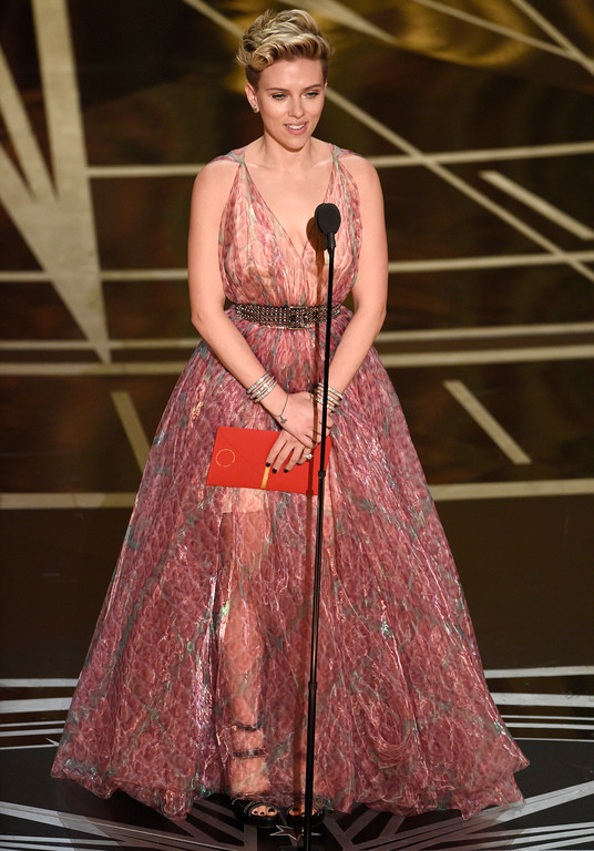 . Scarlett Johansson presents the award for best original song at the Oscars on Sunday, Feb. 26, 2017, at the Dolby Theatre in Los Angeles. (Photo by Chris Pizzello/Invision/AP)