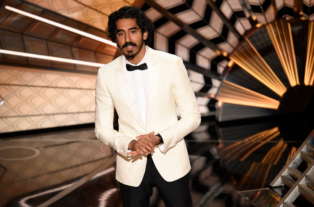 """. Dev Patel introduces a performance for best original song for \""""The Empty Chair\"""" from \""""Jim: The James Foley Story\"""" at the Oscars on Sunday, Feb. 26, 2017, at the Dolby Theatre in Los Angeles. (Photo by Chris Pizzello/Invision/AP)"""