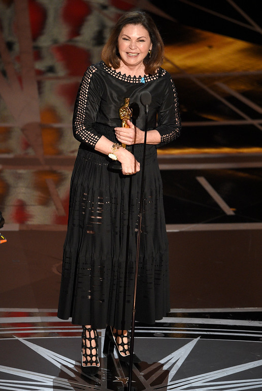 """. Colleen Atwood accepts the award for best costume design for \""""Fantastic Beasts and Where to Find Them\"""" at the Oscars on Sunday, Feb. 26, 2017, at the Dolby Theatre in Los Angeles. (Photo by Chris Pizzello/Invision/AP)"""