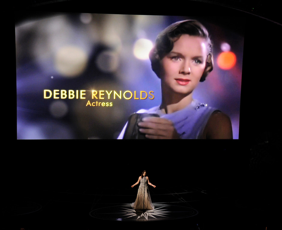 . Sara Bareilles performs during an In Memoriam tribute at the Oscars on Sunday, Feb. 26, 2017, at the Dolby Theatre in Los Angeles. Debbie Reynolds is pictured on screen. (Photo by Chris Pizzello/Invision/AP)