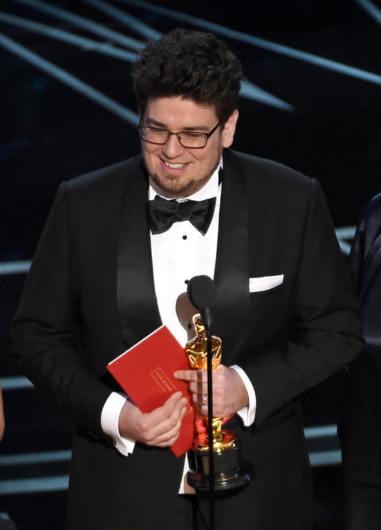 """. Kristof Deak accepts the award for best live-action short film for \""""Sing\"""" at the Oscars on Sunday, Feb. 26, 2017, at the Dolby Theatre in Los Angeles. (Photo by Chris Pizzello/Invision/AP)"""