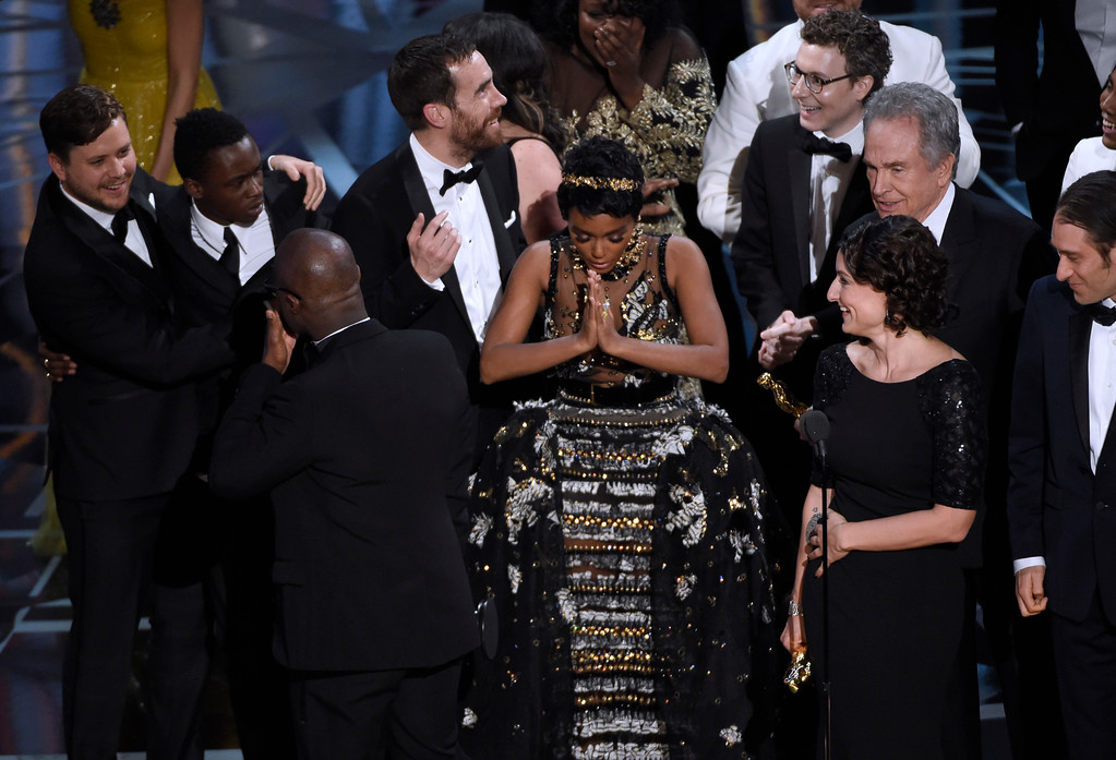 ". Janelle Monae, center, reacts as ""Moonlight\"" is announced as the winner of best picture at the Oscars on Sunday, Feb. 26, 2017, at the Dolby Theatre in Los Angeles. (Photo by Chris Pizzello/Invision/AP)"