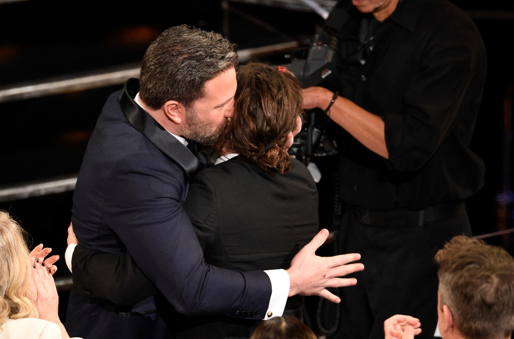 """. Ben Affleck, left, congratulates Casey Affleck as he accepts the award for best actor in a leading role for \""""Manchester by the Sea\"""" at the Oscars on Sunday, Feb. 26, 2017, at the Dolby Theatre in Los Angeles. (Photo by Chris Pizzello/Invision/AP)"""