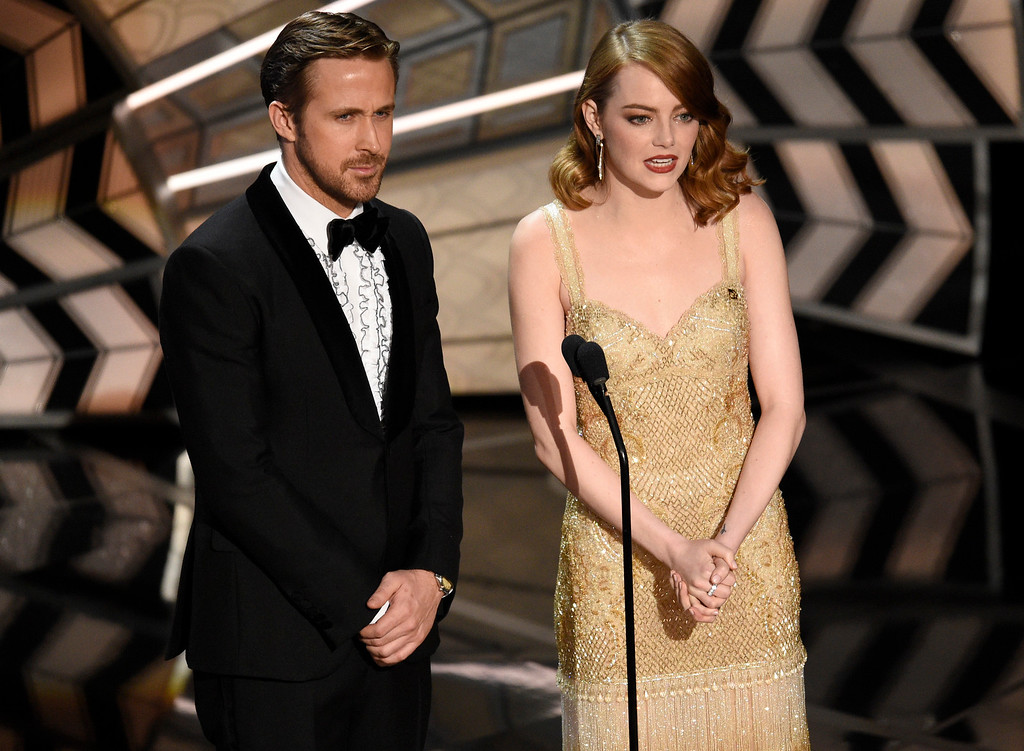 . Ryan Gosling, left, and Emma Stone introduce a performance at the Oscars on Sunday, Feb. 26, 2017, at the Dolby Theatre in Los Angeles. (Photo by Chris Pizzello/Invision/AP)