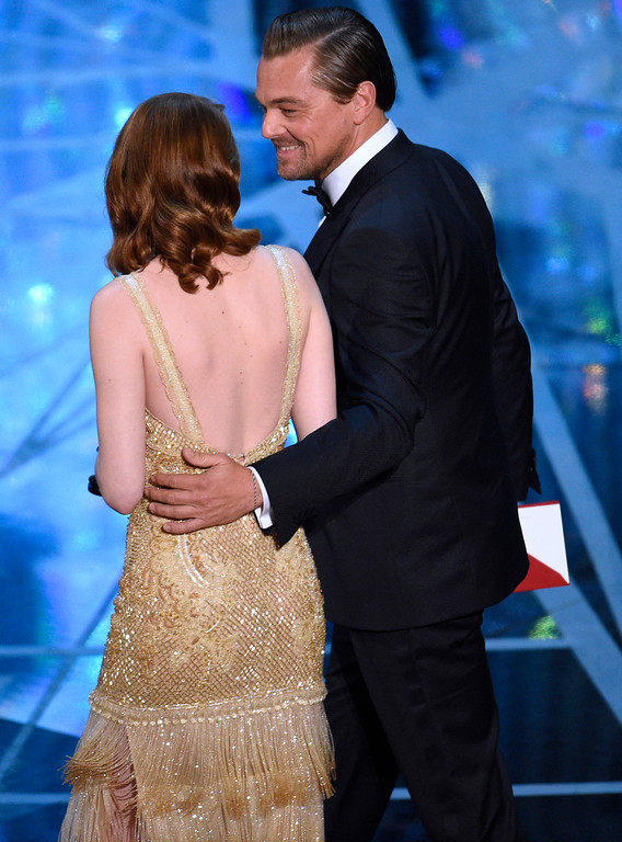 """. Emma Stone, winner of the award for best actress in a leading role for \""""La La Land,\"""" left, is escorted off stage by presenter Leonardo DiCaprio at the Oscars on Sunday, Feb. 26, 2017, at the Dolby Theatre in Los Angeles. (Photo by Chris Pizzello/Invision/AP)"""