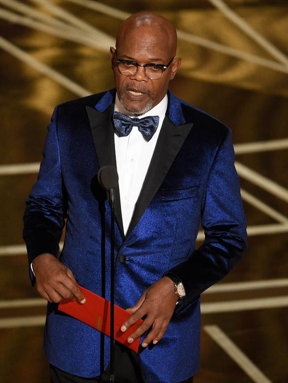 . Samuel L. Jackson presents the award for best original score at the Oscars on Sunday, Feb. 26, 2017, at the Dolby Theatre in Los Angeles. (Photo by Chris Pizzello/Invision/AP)