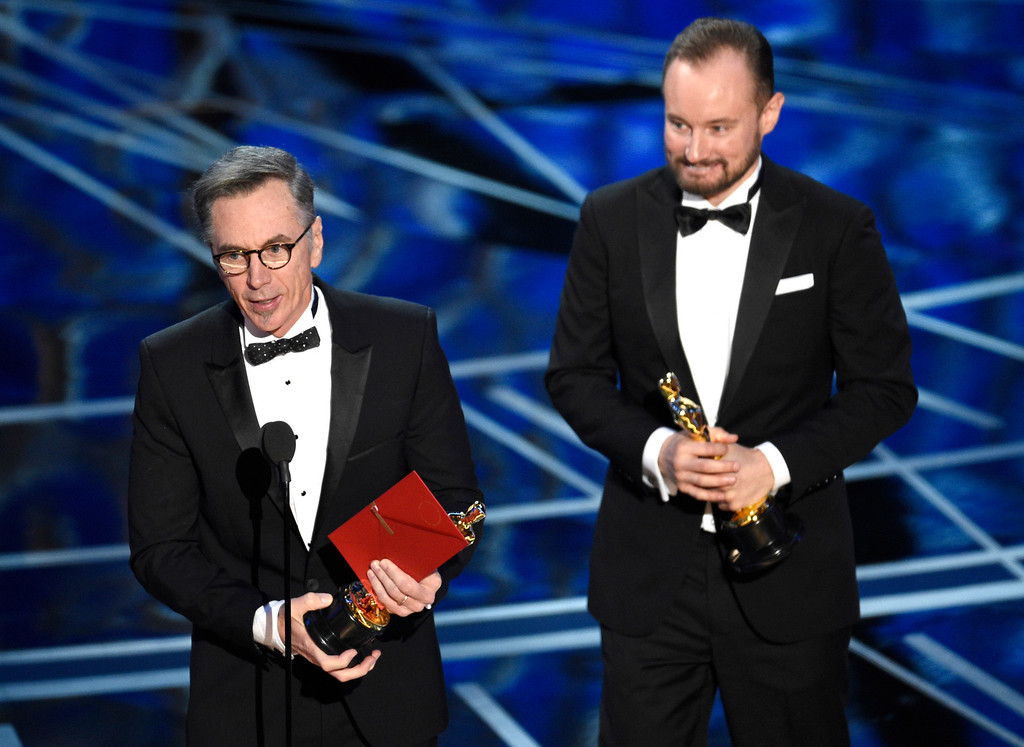 ". Kevin O\'Connell, left, and Andy Wright accept the award for best sound mixing for ""Hacksaw Ridge\"" at the Oscars on Sunday, Feb. 26, 2017, at the Dolby Theatre in Los Angeles. (Photo by Chris Pizzello/Invision/AP)"