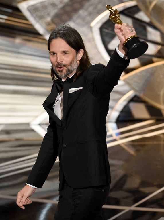 """. Linus Sandgren accepts the award for best cinematography for \""""La La Land\"""" at the Oscars on Sunday, Feb. 26, 2017, at the Dolby Theatre in Los Angeles. (Photo by Chris Pizzello/Invision/AP)"""