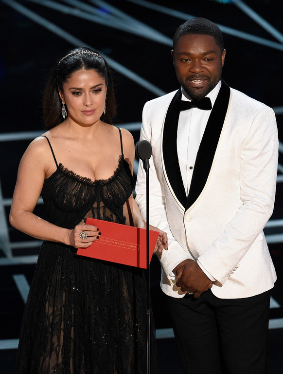 . Salma Hayek, left, and David Oyelowo present the award for best documentary short subject at the Oscars on Sunday, Feb. 26, 2017, at the Dolby Theatre in Los Angeles. (Photo by Chris Pizzello/Invision/AP)