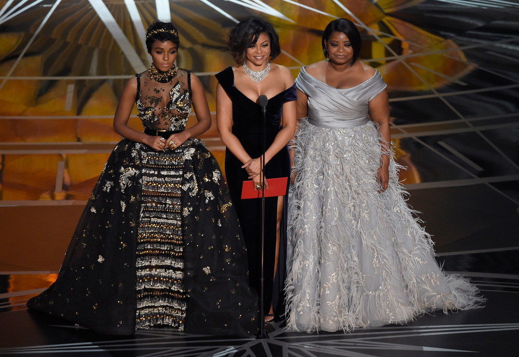 . Janelle Monae, from left, Taraji P. Henson, and Octavia Spencer present the award for best documentary feature at the Oscars on Sunday, Feb. 26, 2017, at the Dolby Theatre in Los Angeles. (Photo by Chris Pizzello/Invision/AP)