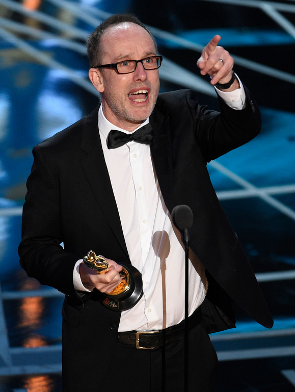 """. John Gilbert accepts the award for best film editing for \""""Hacksaw Ridge\"""" at the Oscars on Sunday, Feb. 26, 2017, at the Dolby Theatre in Los Angeles. (Photo by Chris Pizzello/Invision/AP)"""