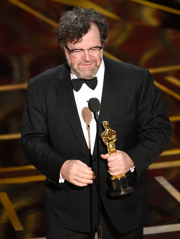 ". Kenneth Lonergan accepts the award for best original screenplay for ""Manchester by the Sea\"" at the Oscars on Sunday, Feb. 26, 2017, at the Dolby Theatre in Los Angeles. (Photo by Chris Pizzello/Invision/AP)"