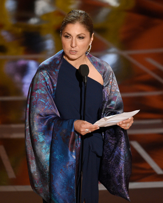 """. Anousheh Ansari accepts the award for best foreign language film for \""""The Salesman\"""" on behalf of Asghar Farhadi at the Oscars on Sunday, Feb. 26, 2017, at the Dolby Theatre in Los Angeles. (Photo by Chris Pizzello/Invision/AP)"""