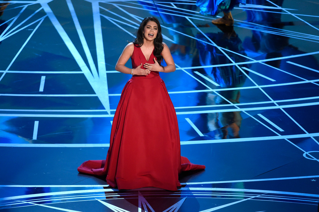 """. Auli\'i Cravalho performs songs from best original song nominee \""""How Far I\'ll Go\"""" from \""""Moana\"""" at the Oscars on Sunday, Feb. 26, 2017, at the Dolby Theatre in Los Angeles. (Photo by Chris Pizzello/Invision/AP)"""