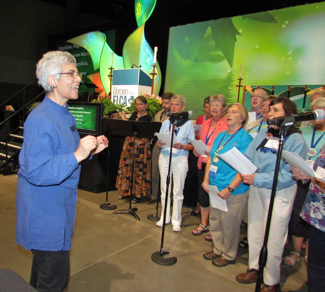 Jane Redmont, author of When in Doubt, Sing: Prayer in Daily Life, led a choir during evening prayer at the Gathering on Friday, July 15.<br /> TL