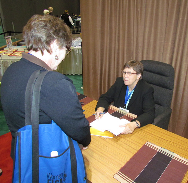"Patricia Lull, author of Gather magazine's (formerly Lutheran Woman Today) 2011-12 Bible study, ""To Follow and To Serve: The Gospel of Mark"" signs a Leader Guide for a participant.<br /> TL"