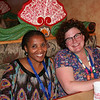 Member of Saturday's response panel Christine Mangale (left), from the Lutheran Office for World Community, shares smiles with a new friend at the dinner for young women at the Azteca restaurant.