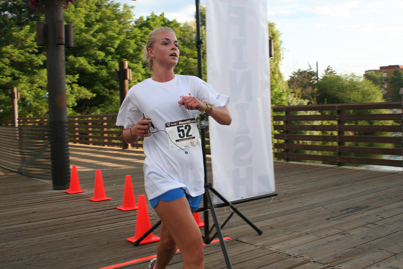 Rachel Zetah Becker  is the third runner to cross the finish line at the 5K Run, Walk and Roll. (BMcB)