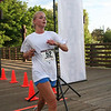 Rachel Zetah Becker  is the third runner to cross the finish line at the 5K Run, Walk and Roll. (BMcB)