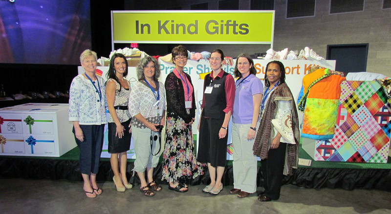 Participants at the Eighth Triennial Gathering collected gift cards, phone cards, health kits, supplies for school kits, quilts, socks, prayer shawls, and support kits for victims of rape or domestic violence to wear home from the hospital. The gifts will go to local agencies and Lutheran World Relief. From left are Beth Wrenn, past Women of the ELCA president; Stephanie Neumann, Lutheran Community Services Northwest; Edie Rice-Sauer and Dia Maurer of Transitions for Women, a Spokane agency; Melanie Gibbons and Emily Sollie of Lutheran World Relief; and Valora Starr, Women of the ELCA. <br /> TL