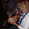 Gathering participants give generously during the final worship service Saturday, July 16.<br /> DB