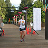 Erin Reynolds is the first runner to cross the finish line at the 5K Run, Walk and Roll. (BMcB)