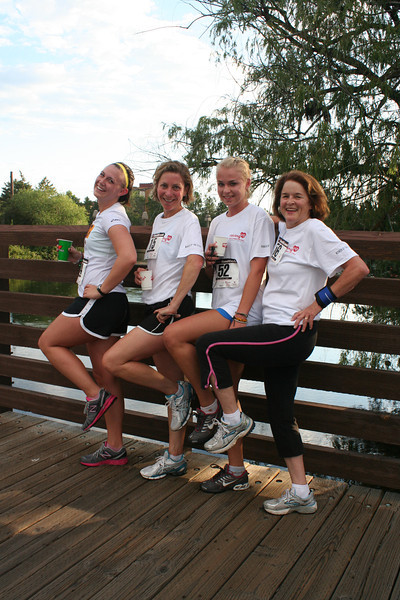 The first four runners to cross the finish line at the 5K Run, Walk and Roll. From the left: Erin Renyolds, Shannon Zetah, Rachel Zetah Becker, and Margie Fiedler. (BMcB)