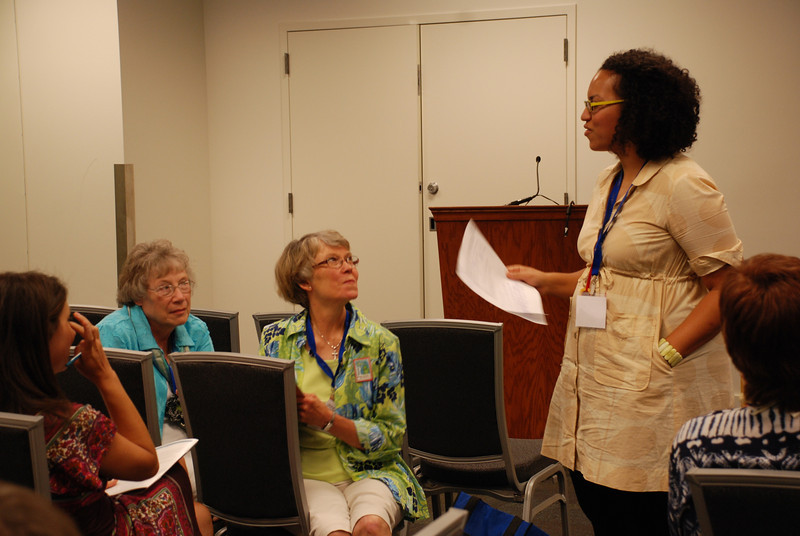 "Presenter Romi Pierce (right) talks with participants in the workshop ""The spirituality of anti-racism."""