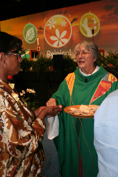 The Rev. Mary Louise Frenchman serves communion at the Saturday night closing worship. Mary Louise was the presiding minister for that service.