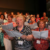 A choir of 250 women sing at the closing worship on Saturday evening. (DB)
