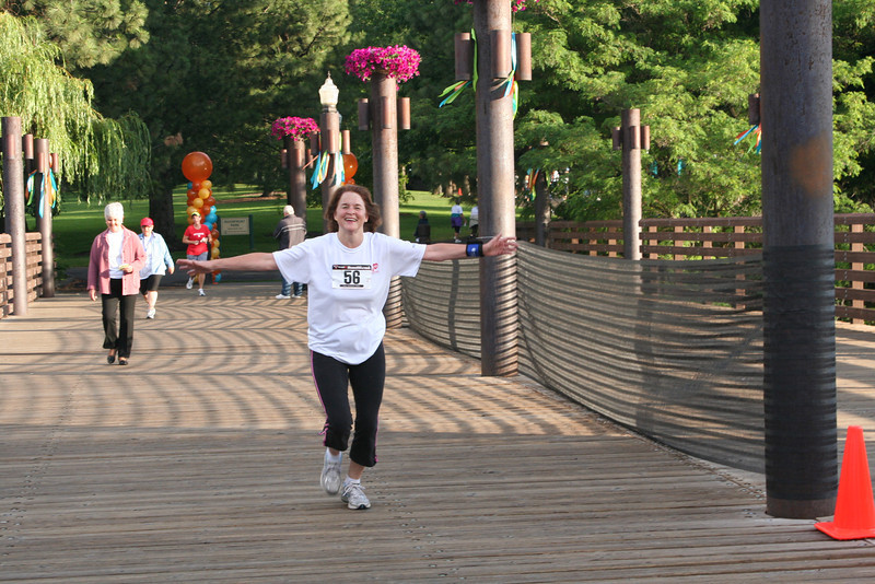 Margie Fiedler runs happily toward the finish line.<br /> (BMcB)