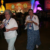 Communion assistants head to  their stations at the closing worship.<br /> (DB)