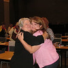 JoAnn Fuchs is congratulated by her daughter Deana.