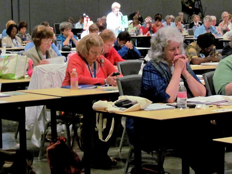 Delegates pray.